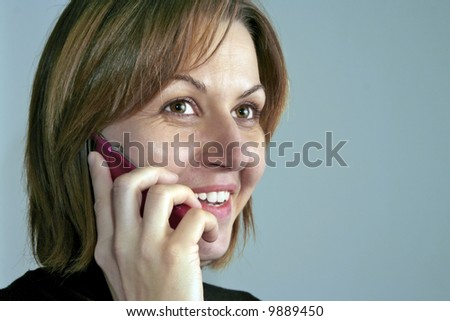 Woman talking on mobile phone and smiling