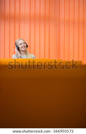 Woman talking on phone with headset