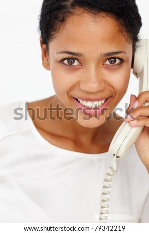 Woman talking on telephone - stock photo