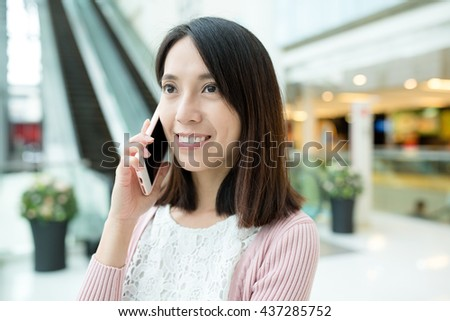 Woman talking to mobile phone