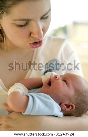 woman talking with her newborn son