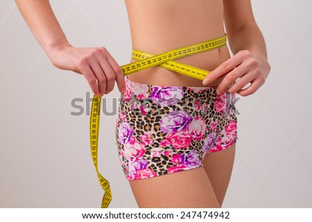 woman tape meter on  belly - stock photo
