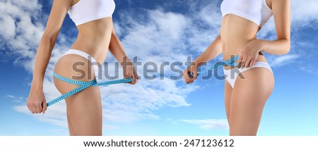 woman tape meter on buttocks and belly - stock photo