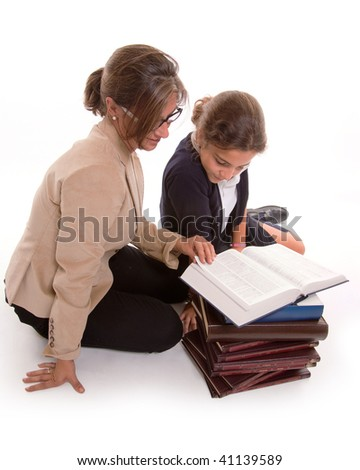 Woman teaching a young schoolgirl isolated on white