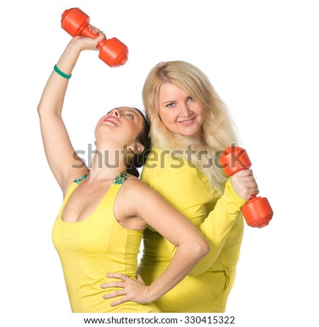 Woman team pumping up muscules with dumbbells