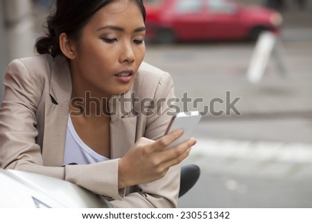 Woman texting on the phone - stock photo