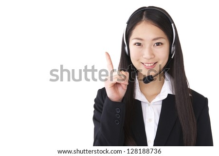 Woman that raised the index finger with a headset