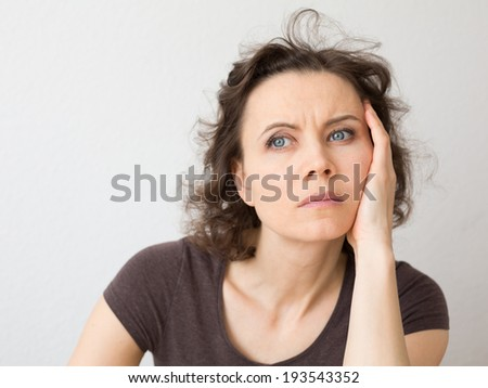 Woman thinking about seriously - stock photo