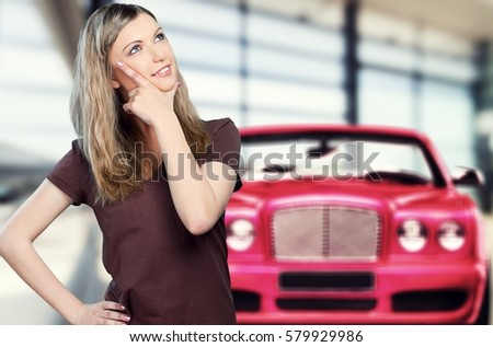 Woman thinking about the car.