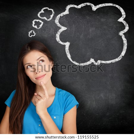 Woman thinking blackboard concept. Pensive girl looking at thought bubble on chalkboard / blackboard texture background. Mixed race Asian Chinese / Caucasian student.