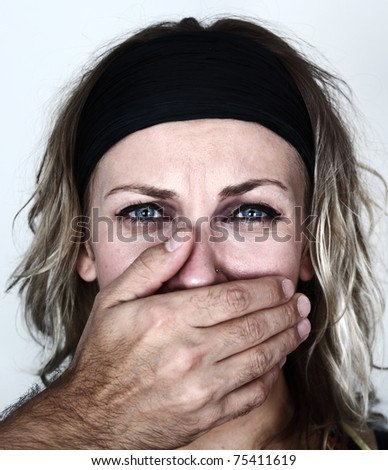 Woman threatened by a male - stock photo
