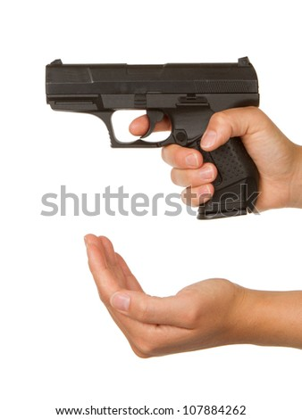 Woman threatening with a black gun, isolated on white