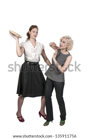 Woman Throwing a Pie - stock photo