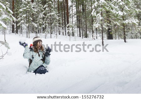 Woman throwing snowball outdoors winter - stock photo