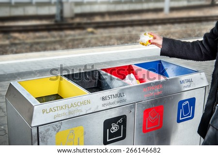 Woman throws paper trash in the trash sorting waste - stock photo