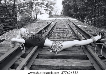 Girl tied to tracks very