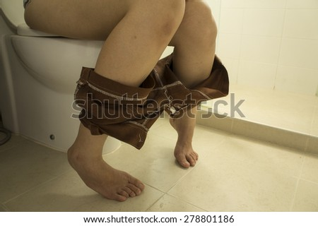 woman toilet lavatory peeing urinate short leg - stock photo