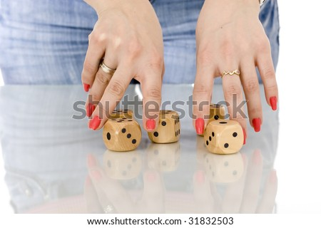 woman touching dice with her fingers 2