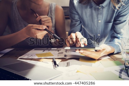 Woman Touching Display Digital Tablet Hand.Project Manager Researching Process.Business Team Working Startup modern Coworking.Analyze market stock.Using electronic device,paper,note wood table.Blurred - stock photo