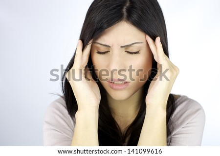 Woman touching head trying to calm the pain - stock photo