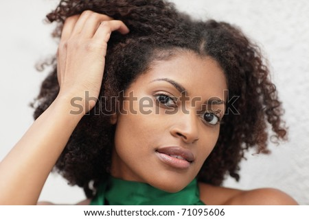 Woman touching her head - stock photo