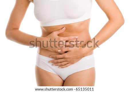 Woman touching her stomach - stock photo