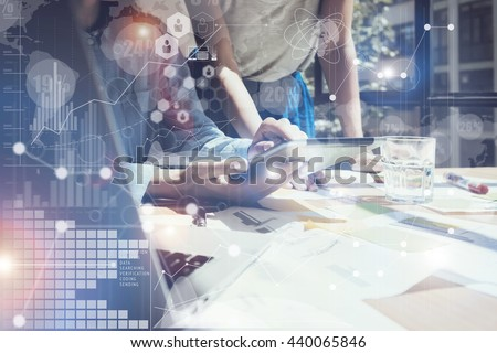 Woman Touching Screen Electronic Tablet Hand.Project Managers Researching Process.Business Team Working New Startup modern Office.International Digital Diagrams Interfaces.Analyze market stock.Blurred - stock photo