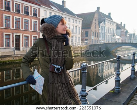 Woman tourist along canal in Bruges, Belgium - stock photo