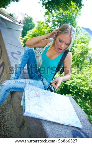woman tourist with map and camera
