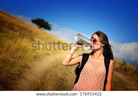 Woman tourist with water bottle outdoors.