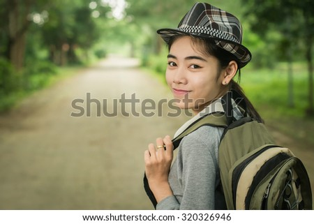 woman tourists are traveling  in backpacker style - stock photo