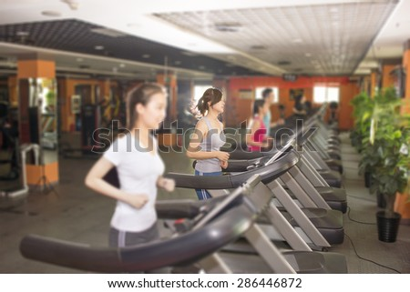 Woman training in a fitness club.  - stock photo
