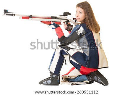 Woman training sport shooting with air rifle gun. - stock photo