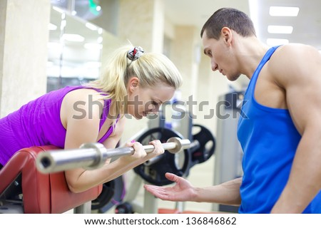 woman training with instructor in gym - stock photo