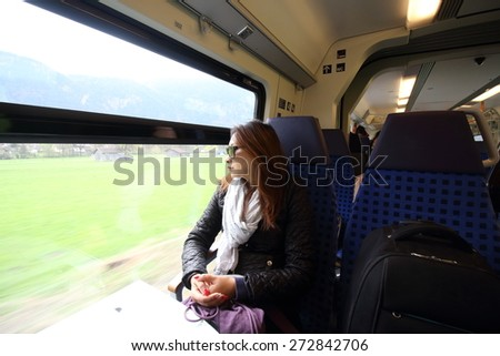 Woman travel by train at famous munich  - germany - bavaria