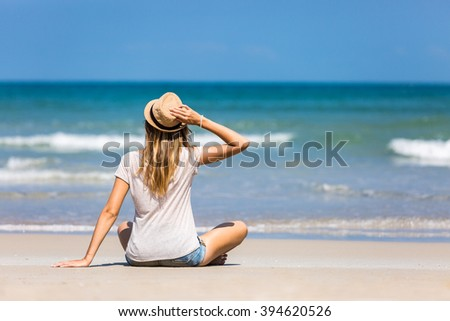 Woman traveler enjoying nice weather on beautiful beach in Vietnam - stock photo