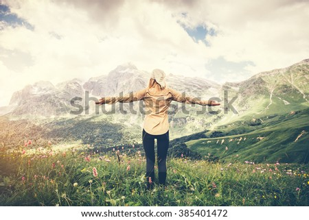 Woman Traveler hands raised walking Travel Lifestyle concept Summer vacations outdoor  mountains on background - stock photo