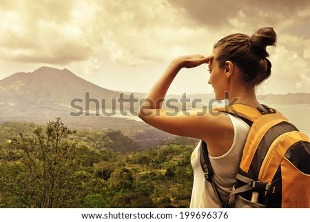 Woman traveler looking at Batur volcano. Indonesia. - stock photo