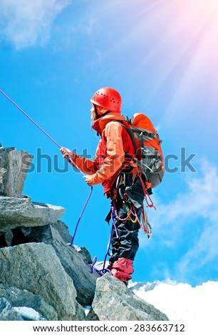Woman Traveler with Backpack hiking in Mountains - stock photo