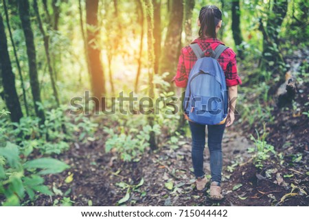 woman traveler with backpack hiking in young hiking holiday.adventure, travel, tourism.