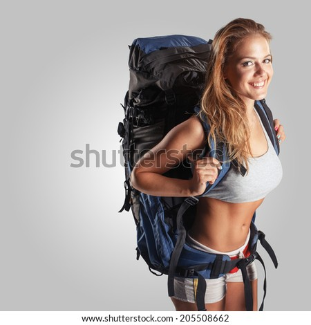 Woman Traveler with Backpack isolated on background - stock photo