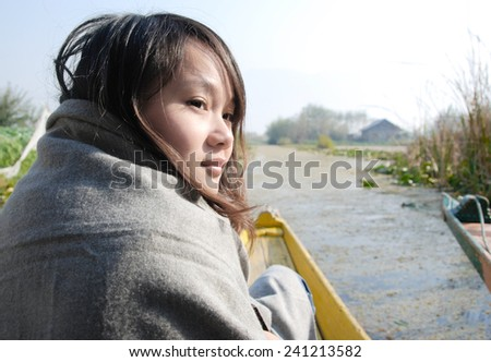 Woman traveling by boat