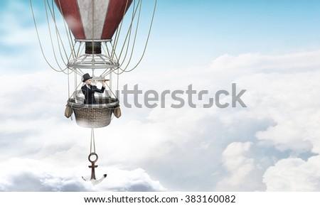 Woman traveling in aerostat - stock photo