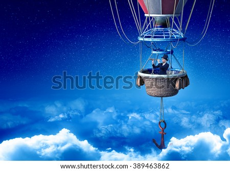 Woman traveling in aerostat - stock photo
