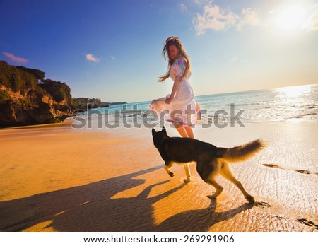 woman traveling with dog near the beach