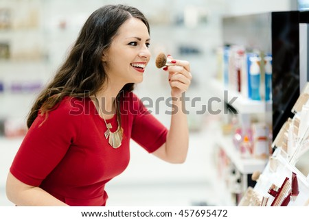 Woman trying cosmetics products in shop