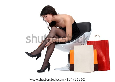 woman trying new stockings - stock photo