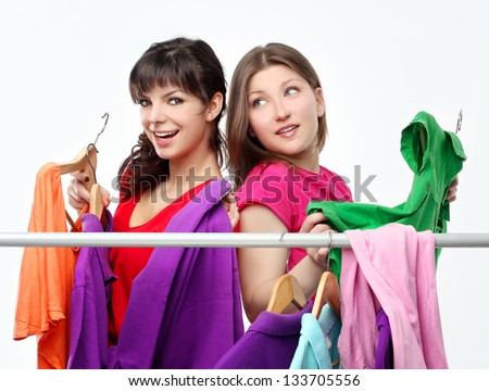 Woman trying on clothing - stock photo