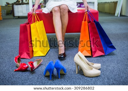 Woman trying on different shoes at the shopping mall