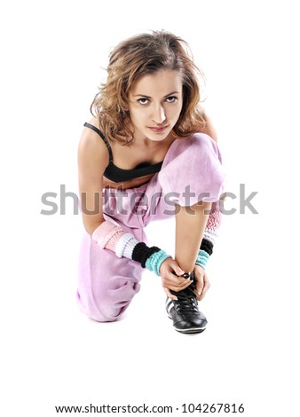 Woman tying shoelaces - stock photo